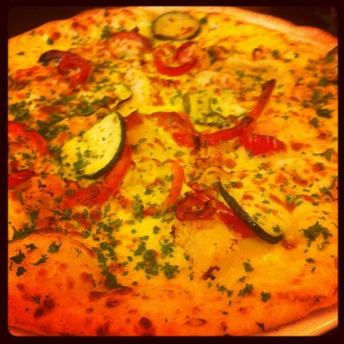 Pizza Argosta that was topped with lobster, saffron, harrisa, red peppers, courgettes, parsley and rosemary.