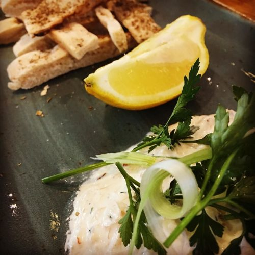 crab & chive mayonnaise with a stack of atbread soldiers & a lemon wedge