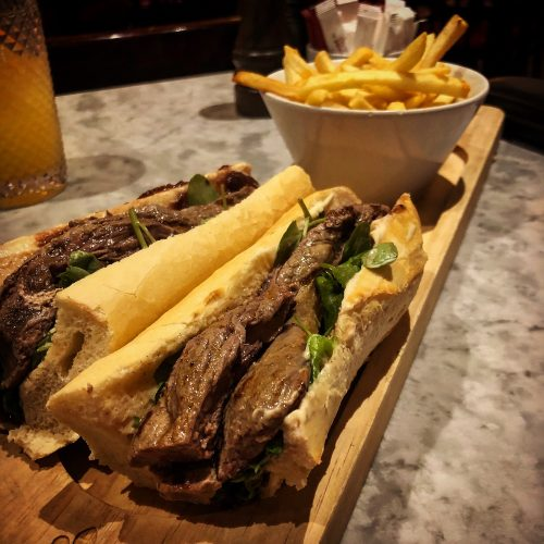 sliced Black Angus rump steak with red onion chutney, watercress and Dijon mayonnaise and served with fries