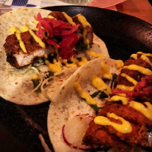 buttermilk chicken flour tacos served crispy fried with pink pickled onions & spiced mayo