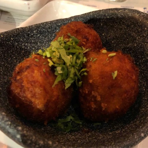 duck croquetas, these are crispy duck & sweet potato balls with smoky hibiscus & chipotle salsa