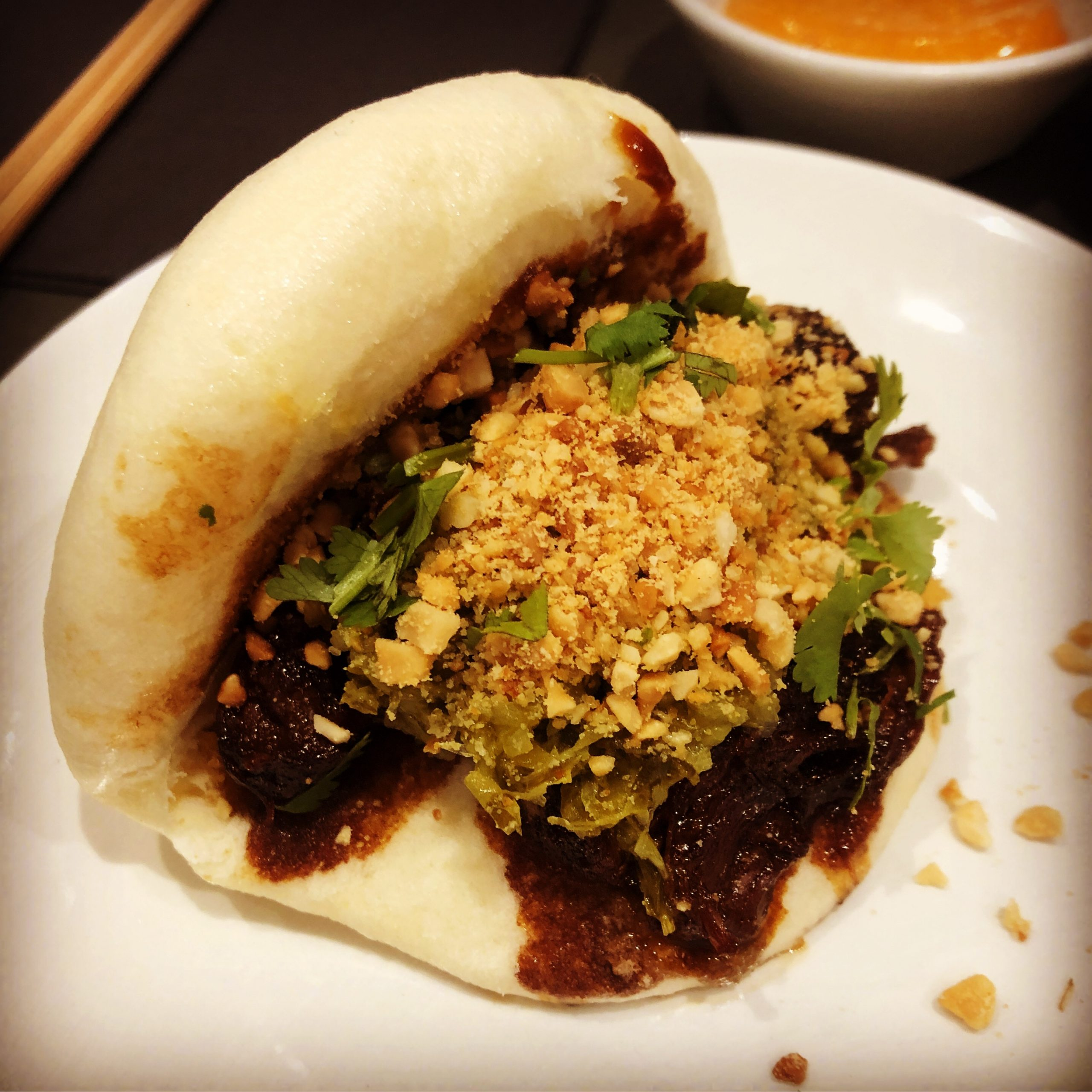 Mr Bao - slow braised pork with house pickles, roasted peanut and coriander